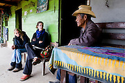 German and Swedish members of ACOGUATE accompaniment group, visiting Jose from the village of Xix. Most of the Xix villagers fled to the mountains after the massacre in February 1982. <br /> Xix, department of El Quiche, Guatemala, October 2011.