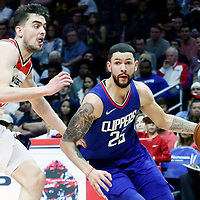 09 December 2017: LA Clippers guard Austin Rivers (25) drives past Washington Wizards guard Tomas Satoransky (31) during the LA Clippers 113-112 victory over the Washington Wizards, at the Staples Center, Los Angeles, California, USA.