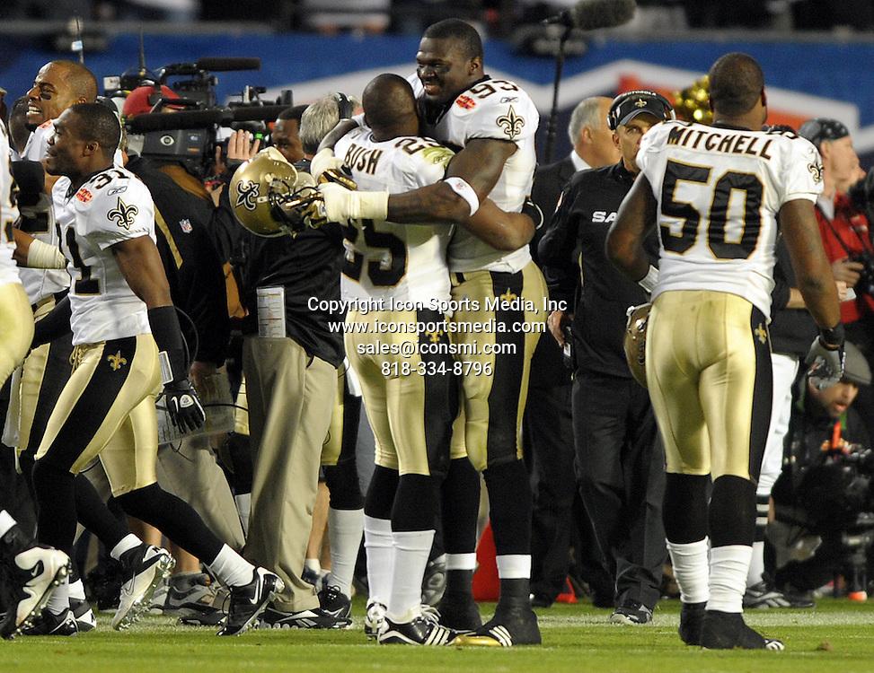 Feb. 07, 2010 - Miami Gardens, FL - Florida, USA - United States - -   New Orleans Saints Reggie Bush hugs Bobby McCray at the end of the game at Super Bowl XLIV at Sun Life Stadium,