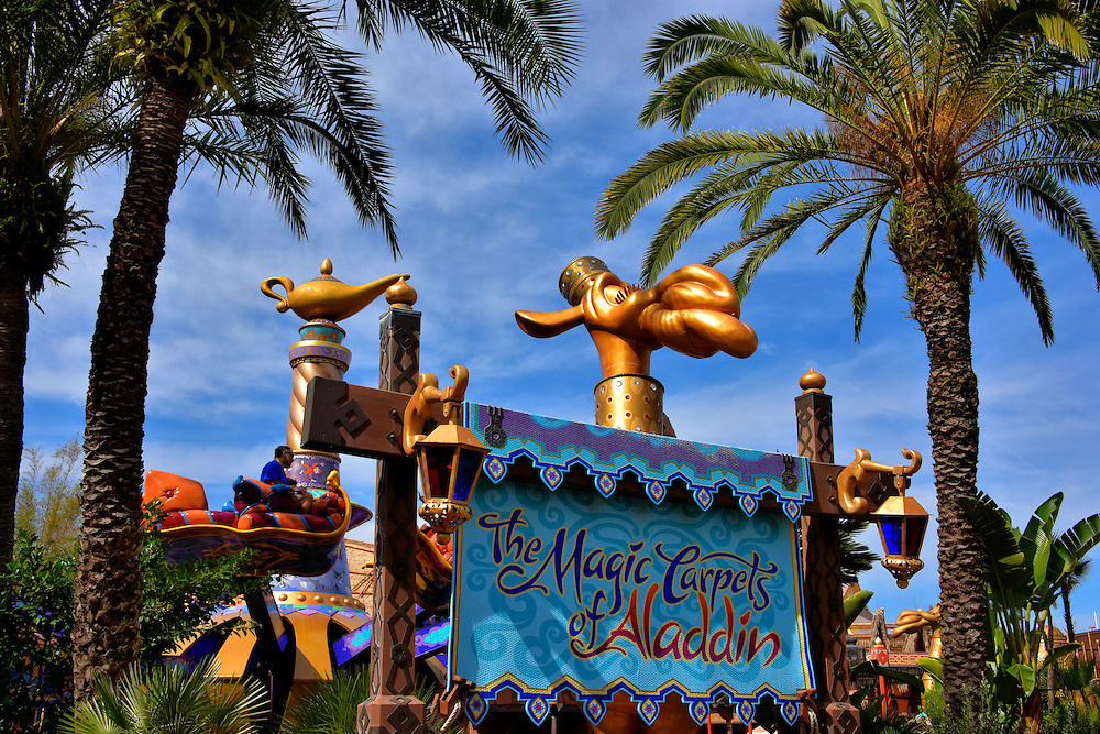 Magic Carpets of Aladdin in Adventureland at Magic Kingdom in Orlando, Florida<br /> The Magic Carpets of Aladdin opened in Adventureland in 2001. The ride&rsquo;s centerpiece is a giant genie bottle adorned with characters from &ldquo;Aladdin,&rdquo; Walt Disney Picture&rsquo;s 1992 animated film. While you are spinning around, remember Princess Jasmine&rsquo;s words to Aladdin, &ldquo;But when I&rsquo;m way up here, it is crystal clear that now I&rsquo;m in a whole new world with you.&rdquo;