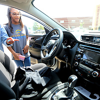 Tupelo High School Drivers Education students Zalaiyah Gilbert and Kasiah Haynes, both eleventh graders, check out the interior of one of the school's new Nissan Rouge's on Thursday before going for a drive.