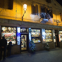 TREVISO, ITALY - DECEMBER 06:  Father and son look at a shop window specialized in Christmas lights on December 6, 2011 in Treviso, Italy. Christmas Markets are popular in Northern Italian cities, selling festive items including lights, nativity scenes, decorations and local festive handicrafts. In most cities they will run from the end of November to January 6th. HOW TO LICENCE THIS PICTURE: please contact us via e-mail at sales@xianpix.com or call our offices in London   +44 (0)207 1939846 for prices and terms of copyright. First Use Only ,Editorial Use Only, All repros payable, No Archiving.© MARCO SECCHI