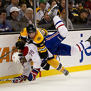 April 27, 2011; Boston, MA, USA; Boston Bruins forward Brad Marchand (63) takes down  Montreal Canadiens defenseman P.K. Subban (76) during the third period at TD Garden. Mandatory Credit: Michael Ivins-US PRESSWIRE