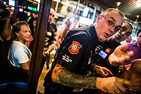 Volunteers of the Foreign Tourist Police settle a small dispute along Walking Street--an infamous entertainment area--in Pattaya, Thailand.