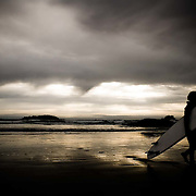 06 Apr 2007, Tofino, British Columbia, Canada --- Surfers at Chesterman's Beach near the town of Tofino on Vancouver Island.  Surfing is popular despite the 52 degree (Fahrenheit) water which requires surfers to wear wetsuits summer and winter. --- Image by © Christopher Morris/Corbis