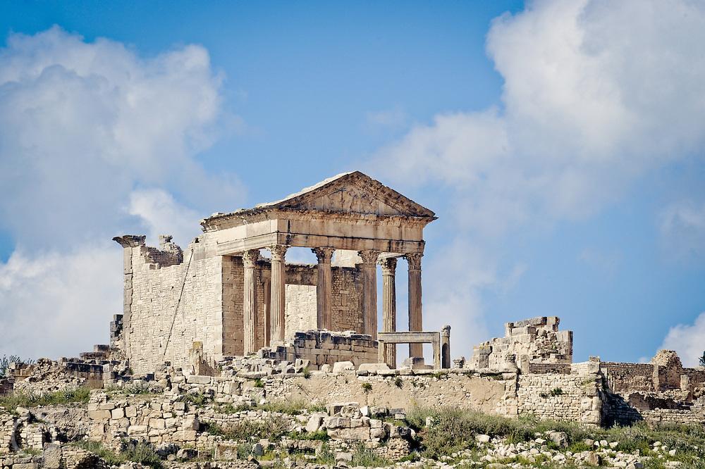 The Roman Capitol at the ruins of Dougga in Tunisia