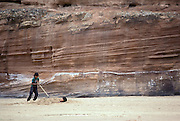 native Indian girls play in the sand of the dry riverbed in Canyon de Chelly National Monument, Arizona