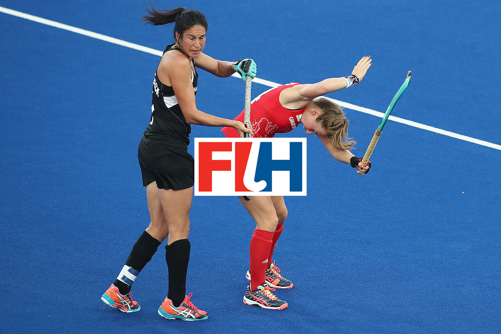 RIO DE JANEIRO, BRAZIL - AUGUST 17:  Kayla Whitelock of New Zealand and Shona Mccallin of Great Britain collide during the womens semifinal match between the Great Britain and New Zealand on Day 12 of the Rio 2016 Olympic Games at the Olympic Hockey Centre on August 17, 2016 in Rio de Janeiro, Brazil.  (Photo by Mark Kolbe/Getty Images)
