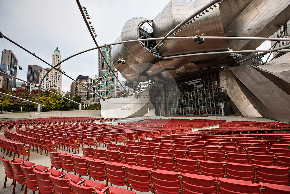 Jay Pritzker Pavilion with downtown skyline at Millennium Park in Chicago USA