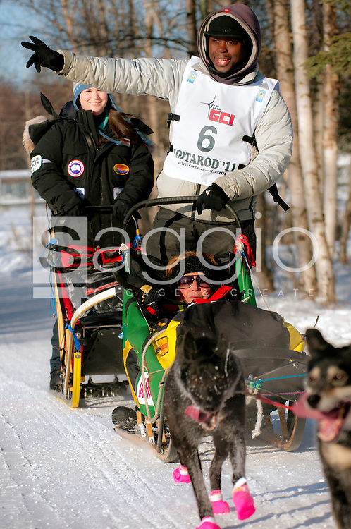 Musher Marshall Newton and Iditarider Marcia Docter stroll along the Chester Creek Trail during the 2011 Ceremonial Start.