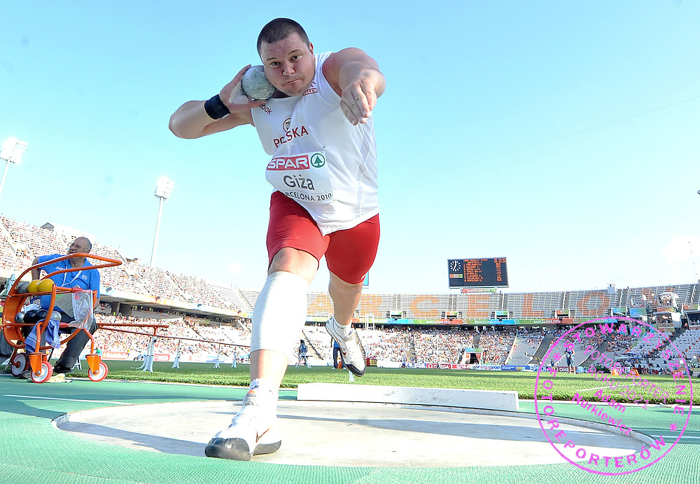 JAKUB GIZA (POLAND) COMPETES IN THE MEN'S SHOT PUT FINAL DURING THE 2010 EUROPEAN ATHLETICS CHAMPIONSHIPS AT OLYMPIC STADIUM IN BARCELONA, SPAIN...SPAIN , BARCELONA , JULY 31, 2010..( PHOTO BY ADAM NURKIEWICZ / MEDIASPORT )..PICTURE ALSO AVAIBLE IN RAW OR TIFF FORMAT ON SPECIAL REQUEST.