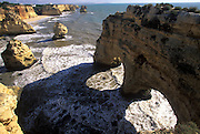 PORTUGAL, ALGARVE, SOUTH COAST Praia Marinha, a beautiful beach in a rocky cove surrounded by sea arches and pinnacles, west of Albufeira