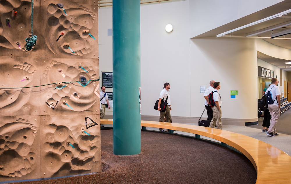 Master's in Athletic Administration students pass by the climbing wall in PIng Center during a walking tour of campus on Friday, June 26, 2015. © Ohio University / Photo by Rob Hardin