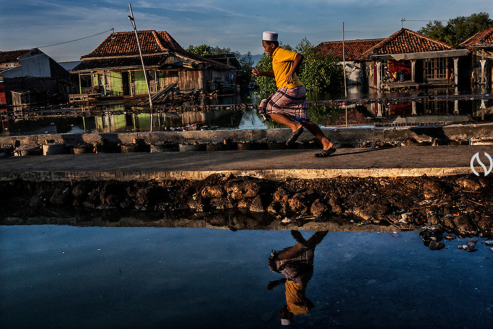 A boy runs on the elevated road in Bedono village, near Semarang.
