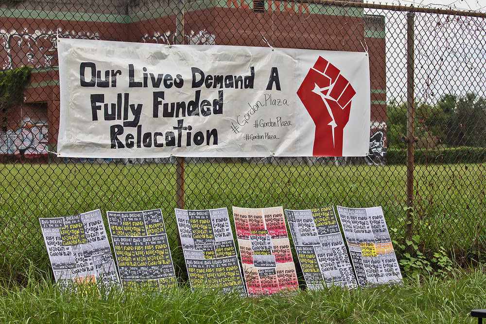 Protest sign on the fence of the Moton Elementary School. during a Rally for Healthy  Neighborhoods: A Vision For the Future, held by residents of Gordon Plaza and their supporters. They demand a fully funded relocation from their homes built on top of the Agriculture Street Landfill Site, on land the city sold them.