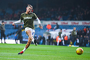 Kalvin Phillips of Leeds United (23) takes a shot whilst warming up during the EFL Sky Bet Championship match between Leeds United and Bristol City at Elland Road, Leeds, England on 24 November 2018.