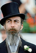 Racegoer in top hat at Epsom Racecourse on Derby Day, UK