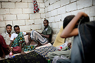 Somali and Etioipen refugges arriving in Aden;Yemen, after being smuggled out of either Djibouti or Bosaso. Many die on the way to Yemen as smugglers throw the refugees overboard or beat them to death. and estimated 150.000 refugees has so far crossed the bay of Aden this year, with the number rising each year.<br /> For individual captions call photographer Jan Grarup or NOOR agency. Somali refugees after arriving the the shore of the Yemeni town of Aden. many are caught and send back to Somalia, other pay for transport further away in hope of a better life.