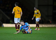3rd November 2018, Fir Park, Motherwell, Scotland; Ladbrokes Premiership football, Motherwell versus Dundee; Andy Boyle of Dundee goes down with a gashed knee