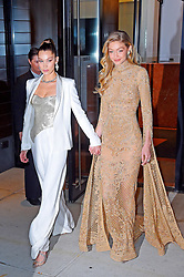 Gigi Hadid takes a tumble as she steps on her own dress as she heads out with sister Bella. Their mom Yolanda and brother Anwar also headed out to the Glamour Awards. Gigi wore Zuhair Murad dress and Christian Louboutin shoes. 13 Nov 2017 Pictured: Gigi Hadid, Bella Hadid, Yolanda Hadid, Anwar Hadid. Photo credit: MEGA TheMegaAgency.com +1 888 505 6342