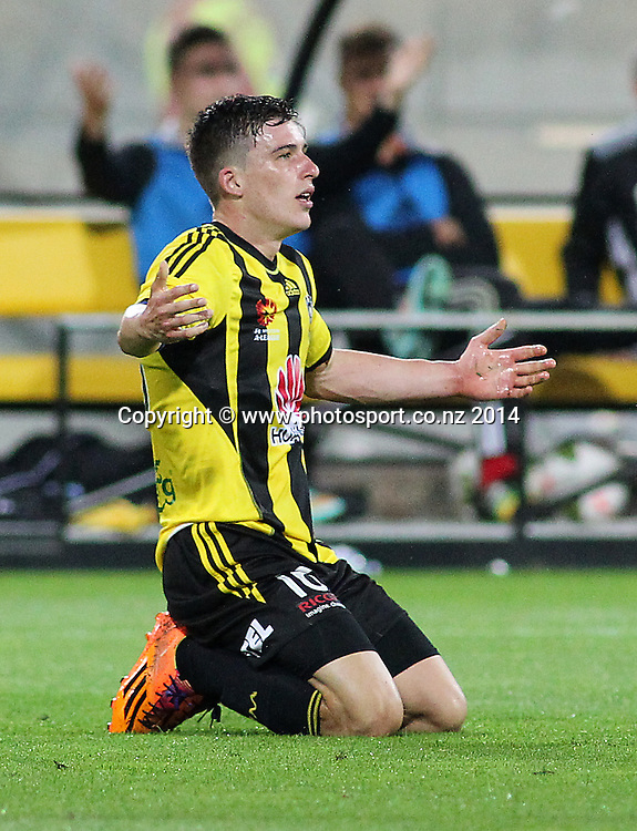 Phoenix Louis Fenton appeals to the referee during the A-League football match between the Wellington Phoenix & Western Sydney Wanderers at Westpac Stadium, Wellington, 28 December 2014. Photo.: Grant Down / www.photosport.co.nz