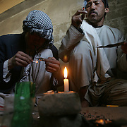 Dozens of heroin addicts have occupied a complex of  buildings ruined during the civil war. Here they live with no furniture, cooking or washing facilities. They smoke heroin through paper tubes after heating it on small pieces of foil. Intravenous drug use is increasing and the ground is littered with used syringes and needles. Kabul, Afghanistan on the 6th of November 2007.