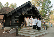 PRICE CHAMBERS / NEWS&amp;GUIDE<br /> Clad in park-service brown, the log structure opens its doors to visitors and Bishop Paul D. Etienne of the Diocese of Cheyenne, who leads a Mass commemorating the chapel's 75 years on August 15.