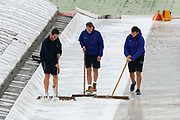 Ground staff clearing the water off the covers after the rain stopped after lunch during the International Test Match 2019 match between England and Australia at Lord's Cricket Ground, St John's Wood, United Kingdom on 14 August 2019.