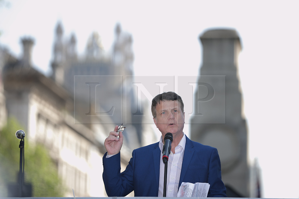 """© Licensed to London News Pictures . 06/05/2018. London, UK. GERARD BATTEN speaks at the demo. Supporters of alt-right and anti-Islam groups, including Generation Identity and the Democratic Football Lads Alliance, demonstrate at Whitehall in Westminster, opposed by anti-fascists. Speakers billed in the """"Day for Freedom"""" include former EDL leader Tommy Robinson, Milo Yiannopoulos, youtuber Count Dankula (Markus Meechan), For Britain leader Anne Marie Waters, UKIP leader Gerard Batten, Breitbart's Raheem Kassam and Lauren Southern. The event was originally planned as a march to Twitter's HQ in protest at their banning of Robinson and the Home Office's ban on Martin Sellner and Brittany Pettibone entering the UK, in what protesters describe as limits being imposed on free speech. Photo credit: Joel Goodman/LNP"""