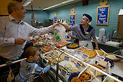 Nico Engel, architect, with his family shopping on Saturday for one week's worth of food near his home in Luxembourg. Model Released. The image is part of a collection of images and documentation for Hungry Planet 2, a continuation of work done after publication of the book project Hungry Planet: What the World Eats.