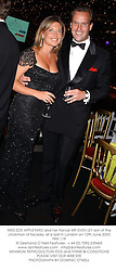 MISS ZOE APPLEYARD and her fiancé MR SVEN LEY son of the chairman of Escada, at a ball in London on 12th June 2003.PKK 119