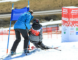 17.03.2017, Schladming, AUT, Special Olympics 2017, Wintergames, Ski Alpin, Einteilung Kategorie Novice, im Bild ein Helfer, der einem gestürzten Teilnehmer hilft // volunteer and athlete during the Ski Alpine Assessment Novice at the Special Olympics World Winter Games Austria 2017 in Schladming Austria on 2017/03/17. EXPA Pictures © 2017, PhotoCredit: EXPA / Martin Huber