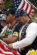 Members of the Patriot Guard Riders are taking a minute of silence and mourning during the funeral service of Sgt. Ian T. Sanchez, in Staten Island, NY., on Tuesday, June 27, 2006. Sgt. Sanchez, a 26-year-old American serviceman was killed by a roadside bomb in the Pech River Valley, Afghanistan. The Patriot Guard Riders is a diverse amalgamation of riders from across the United States of America. Besides a passion for motorcycling, they all have in common an unwavering respect for those who risk their lives for the country's freedom and security. They are an American patriotic group, mainly but not only, composed by veterans from all over the United States. They work in unison, calling upon tens of different motorcycle groups, connected by an internet-based web where each of them can find out where and when a 'Mission' is called upon, and have the chance to take part. This way, the Patriot Guard Riders can cover the whole of the United States without having to ride from town to town but, by organising into different State Groups, each with its own State Captain, they are still able to maintain strictly firm guidelines, and to honour the same basic principles that moves the group from the its inception. The main aim of the Patriot Guard Riders is to attend the funeral services of fallen American servicemen, defined as 'Heroes' by the group,  as invited guests of the family. These so-called 'Missions' they undertake have two basic objectives in particular: to show their sincere respect for the US 'Fallen Heroes', their families, and their communities, and to shield the mourners from interruptions created by any group of protestors. Additionally the Patriot Guard Riders provide support to the veteran community and their families, in collaboration with the other veteran service organizations already working in the field.   **ITALY OUT**