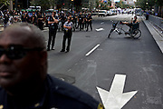 Law enforcement and stands watch along College Street as protesters gather during the 2012 Democratic National Convention on Wednesday, September 5, 2012 in Charlotte, NC.
