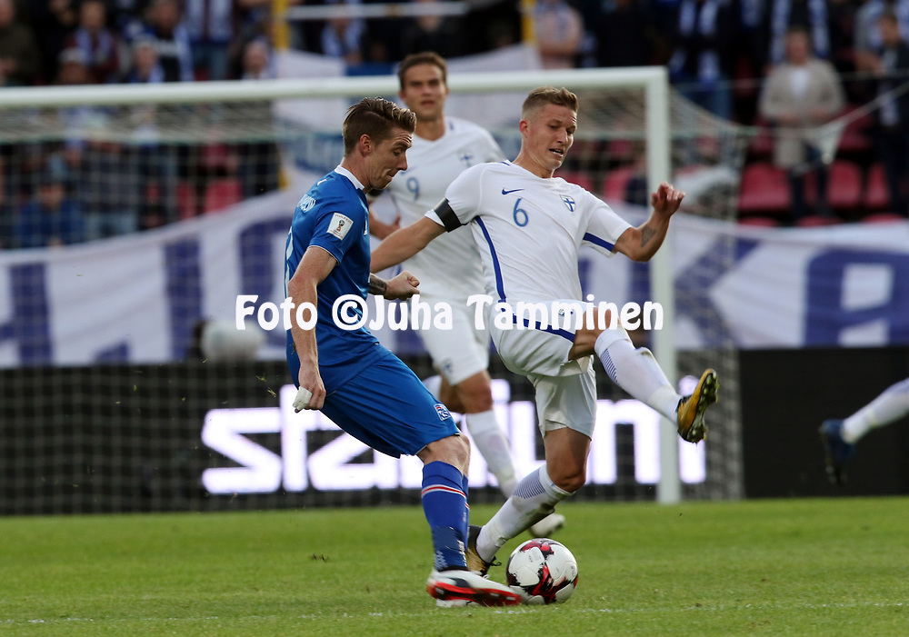 2.9.2017, Ratina Stadion, Tampere, Finland.<br /> FIFA World Cup 2018 Qualifying match, Finland v Iceland.<br /> Birkir S&aelig;varsson (Iceland) v Alexander Ring (Finland).
