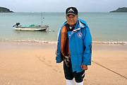 Mr Akinobu TAMAKI, 77, (玉城昭旦) is a fisherman, his sons are also fishermen. He says about the new base that he feels &quot;half against, half insecure&quot;.<br /> <br /> He's standing in front of his boat on the Abu beach, located next to Henoko, on the North East side of Oura bay, where a U.S.-operated Osprey ditched into the sea last December, injuring its crew of five after a hose connected to the aircraft broke during a refueling exercise.<br /> <br /> Fishermen of the area are paid by the government to guard with their small boats the off shore limits of the construction site. A job better paid and less risky than going fishing. <br /> <br /> <br /> The Osprey aircraft has become a lightning rod for opposition to the U.S. military presence in Okinawa, with local groups seeking the closure of American bases saying it is prone to crash and poses a danger to residents.