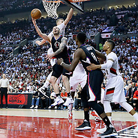 25 April 2016: Los Angeles Clippers guard J.J. Redick (4) goes for the reverse layup past Portland Trail Blazers center Mason Plumlee (24) during the Portland Trail Blazers 98-84 victory over the Los Angeles Clippers, during Game Four of the Western Conference Quarterfinals of the NBA Playoffs at the Moda Center, Portland, Oregon, USA.