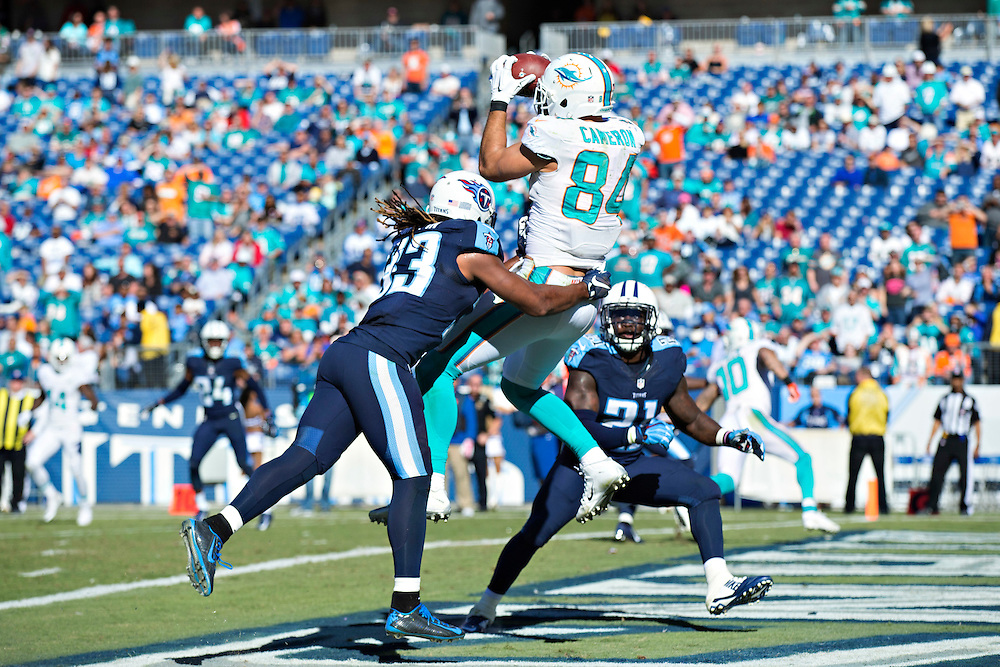 NASHVILLE, TN - OCTOBER 18:  Jordan Cameron #84 of the Miami Dolphins catches a touchdown pass over Michael Griffin #33 of the Tennessee Titans at LP Field on October 18, 2015 in Nashville, Tennessee.  The Dolphins defeated the Titans 38-10.  (Photo by Wesley Hitt/Getty Images) *** Local Caption *** Jordan Cameron; Michael Griffin