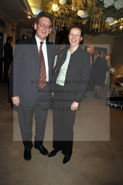VISCOUNT & VISCOUNTESS DUPPLIN at the Sotheby's Summer Party 2007 at their showrooms in New Bond Street, London on 4th June 2007.<br />