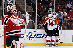 Oct 3, 2009; Newark, NJ, USA; The Philadelphia Flyers celebrate a goal by Philadelphia Flyers defenseman Matt Carle (25) during the third period at the Prudential Center. The Flyers defeated the Devils 5-2.  Mandatory Credit: Ed Mulholland-US PRESSWIRE