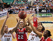 Boston College's Kerri Shields (10) and Tiffany Ruffin (31) battle NC State's Bonae Holston (22) for this loose ball during NC State's narrow 71 - 70 victory in the first round of the 2011 ACC Women's Basketball Tournament held at the Greensboro Coluseum in Greensboro, North Carolina.  (Photo by Mark W. Sutton)