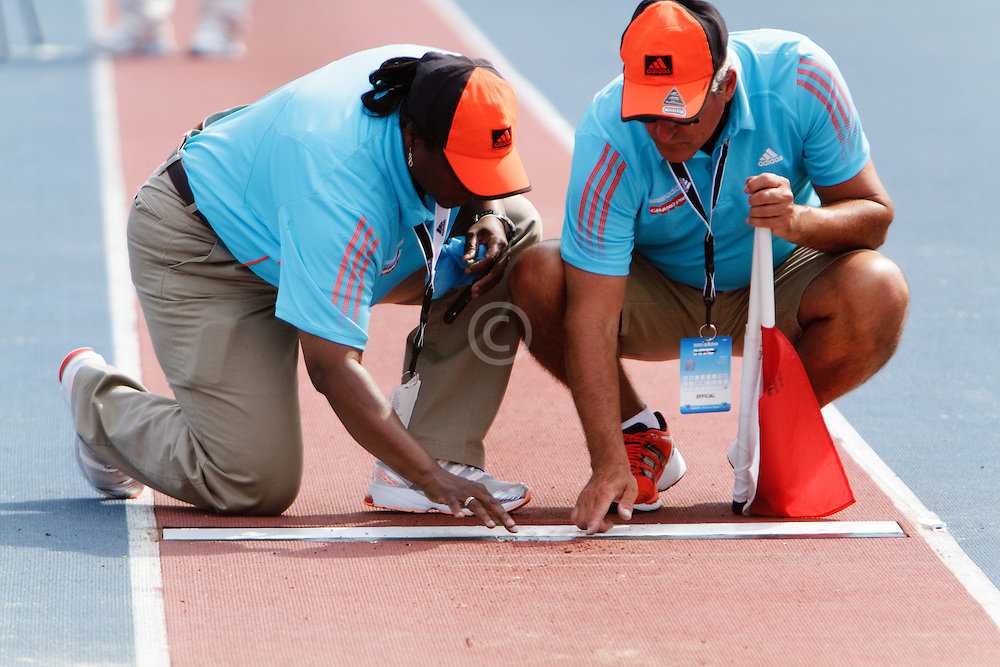 Samsung Diamond League adidas Grand Prix track & field; officials check mark on takeoff strip of long jump