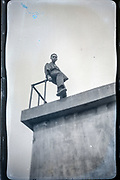 portrait of a young adult man sitting on top of a structure Japan ca 1940s
