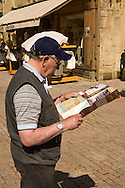 Male Tourist reading a map