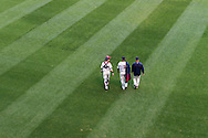 Samuel Deduno #21, Chris Herrmann #12, and Rick Anderson #40 of the Minnesota Twins head to the dugout before a game against the Milwaukee Brewers on May 29, 2013 at Target Field in Minneapolis, Minnesota.  The Twins defeated the Brewers 4 to 1.  Photo: Ben Krause