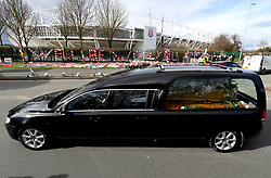 The Gordon Banks funeral cortege passes by tributes from fans at the bet365 Stadium, Stoke.