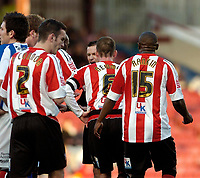 Photo: Leigh Quinnell.<br /> Brentford v Huddersfield Town. Coca Cola League 1. 21/01/2006. Referee Keith Stroud sends off Brentfords Ricky Newman(centre)