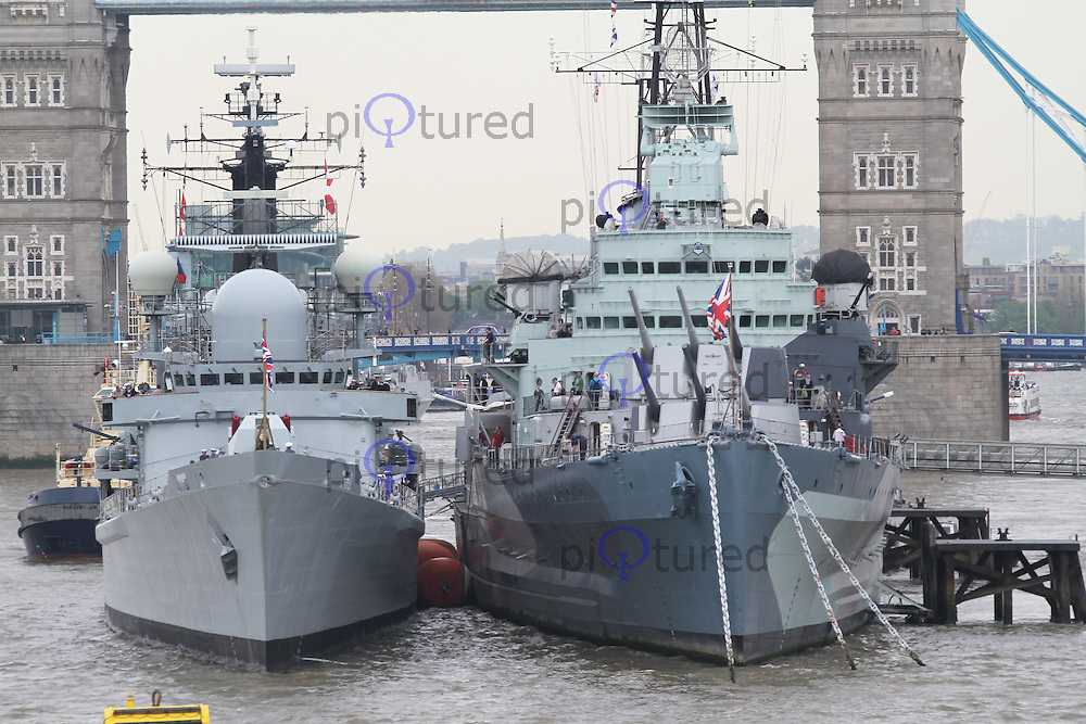HMS Edinburgh is the last Royal Navy Type 42 Destroyer. This is her final visit to London to participate in the Royal Navy nationwide commemorations of the 70th anniversary of the Battle of the Atlantic. She will shortly be decommissioned after 30 years of service to the Royal Navy. Tower Bridge London UK, 07 May 2013, (Photo by Richard Goldschmidt)