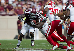 Texas A&M running back Keith Ford (7) is tackled by Louisiana-Lafayette defensive tackle Kevon Perry (90) during the first quarter of an NCAA college football game Saturday, Sept. 16, 2017, in College Station, Texas. (AP Photo/Sam Craft)