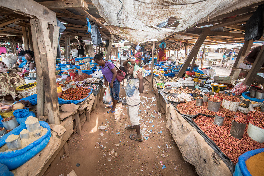 A boy and his mother shop in the market in Ganta, Liberia